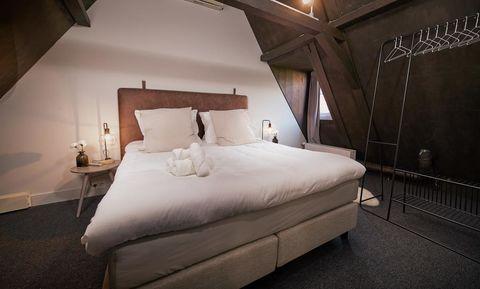 Cottage met luxe bad en uitzicht op de Amstel