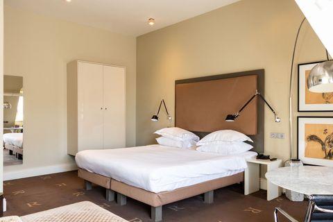 Luxe kamer met bad in boutique hotel
