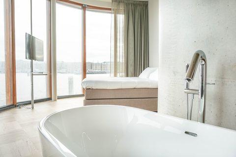 Luxe suite in Amsterdam direct aan de rivier